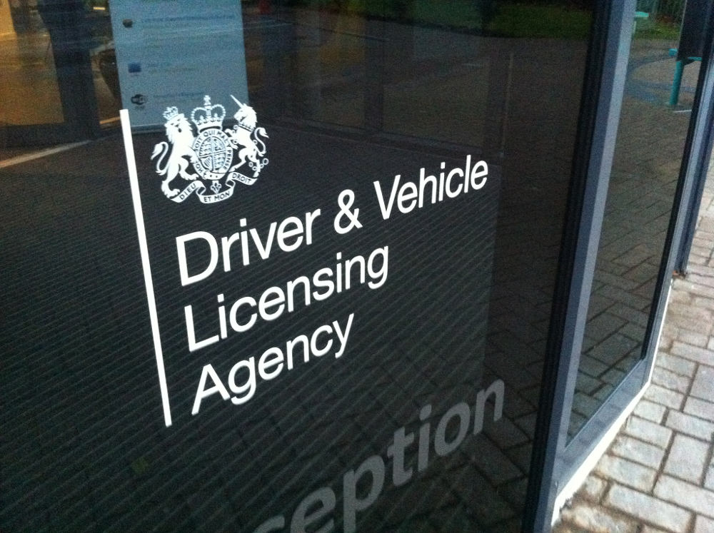 Front doors with logo of the DVLA (Driver and Vehicle Licensing Agency)