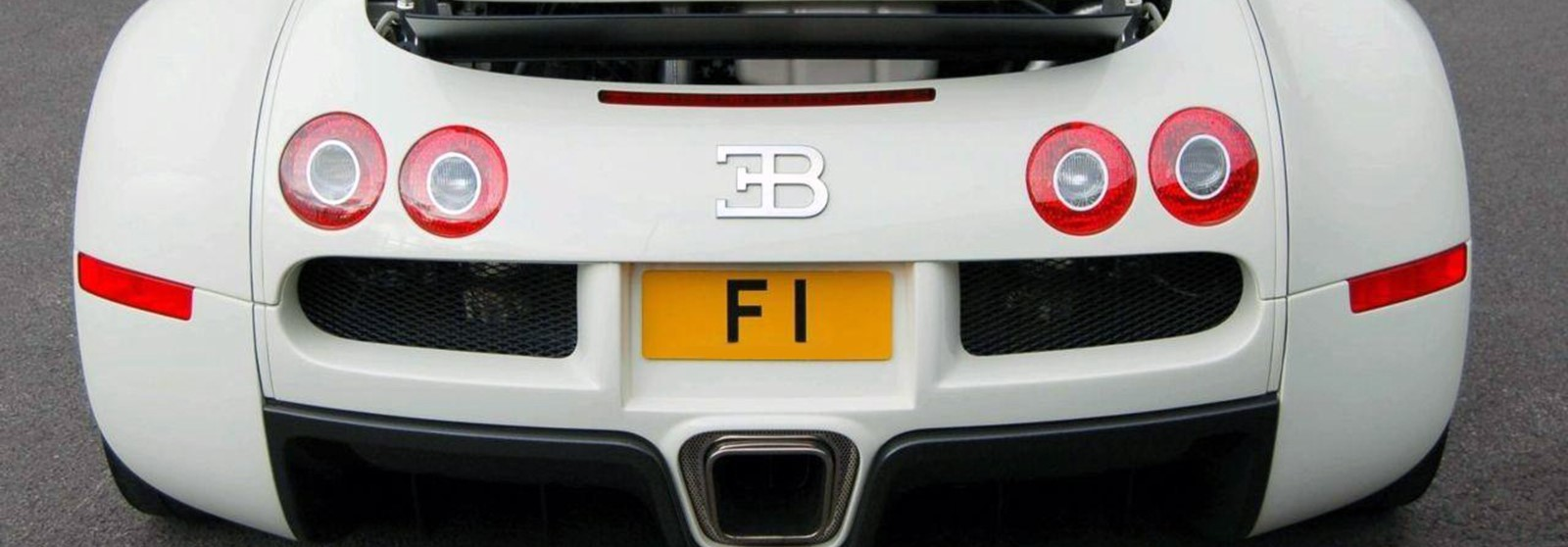 Bugatti car fitted with one of most expensive number plates. F1 registration plate .